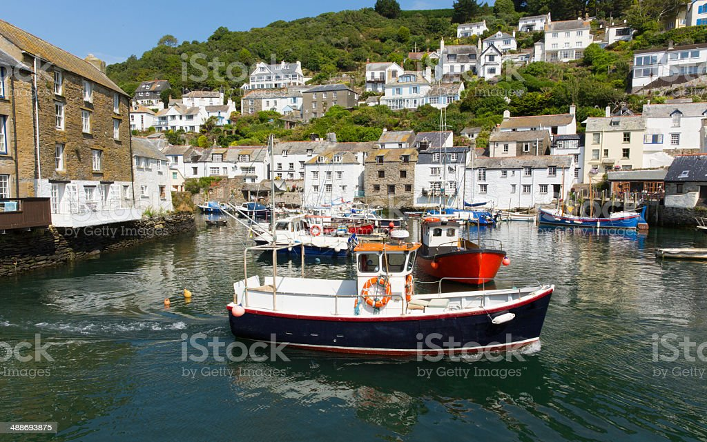 Fishing boat in Cornwall harbour Polperro England stock photo