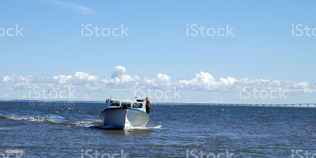 Fishing Boat in front of Confederation Bridge royalty-free stock photo