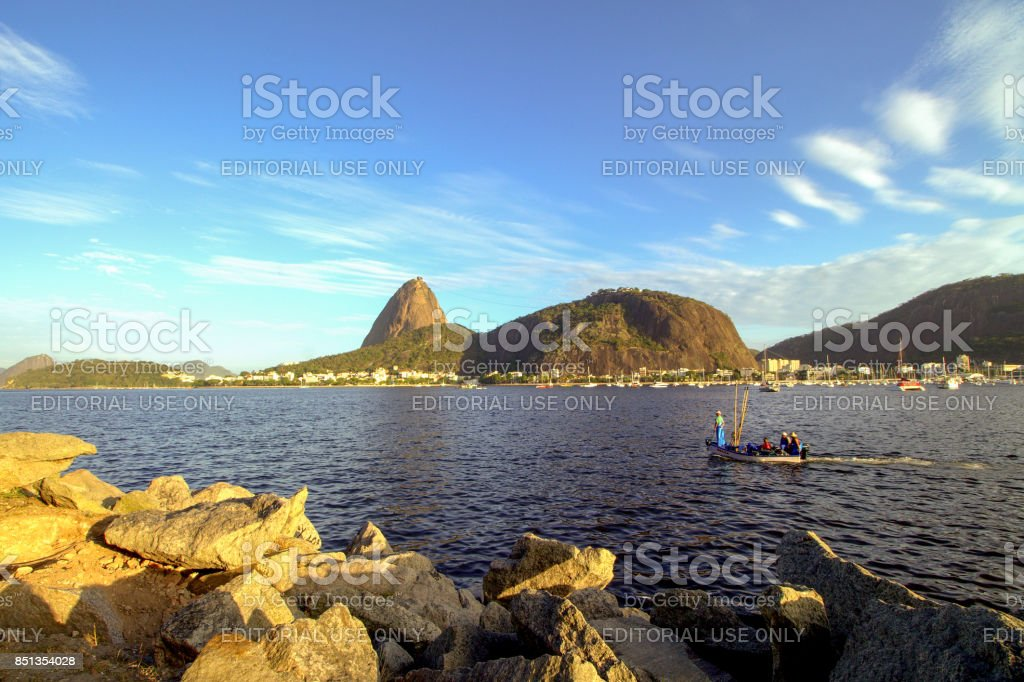 Fishing boat in front of sugar loaf stock photo