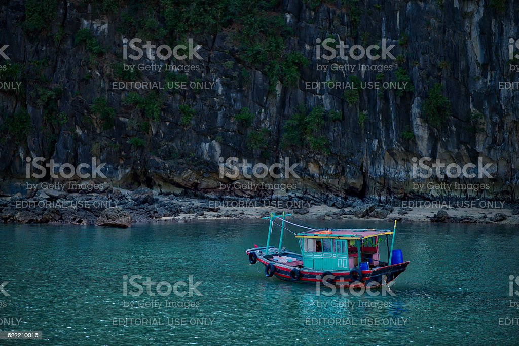 Fishing boat in Halong Bay stock photo