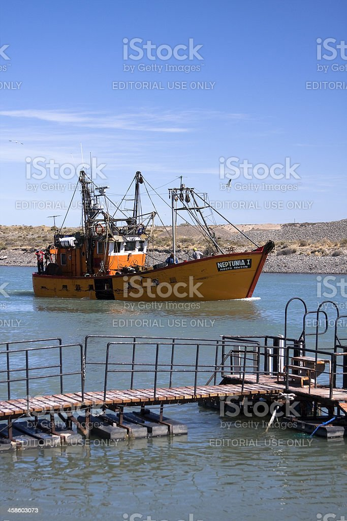 Fishing boat in 'Puerto Rawson' royalty-free stock photo