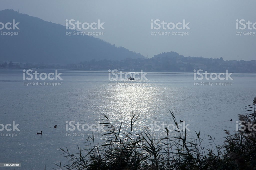 Fishing Boat in silhouette stock photo