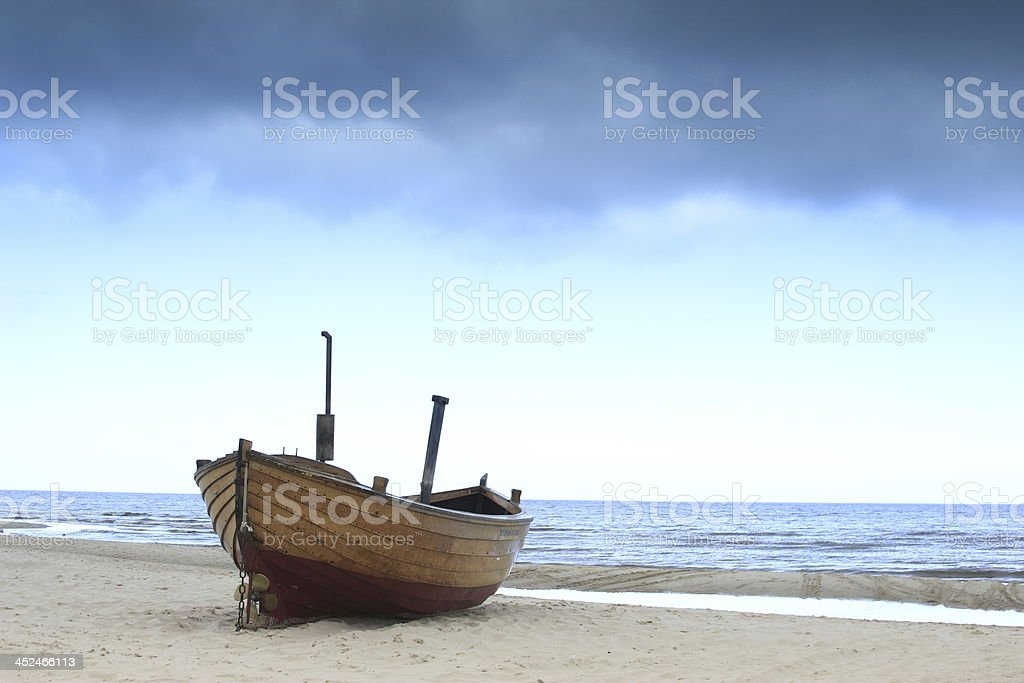 Fishing boat in stormy weather stock photo