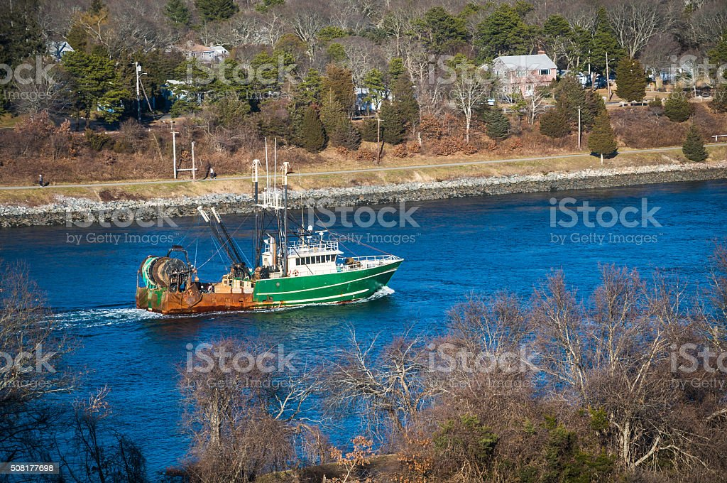 Fishing Boat in the Canal stock photo