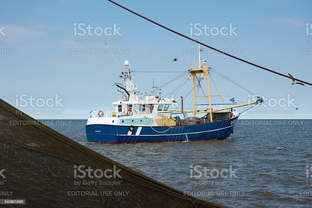 Fishing boat in the Dutch waters near Texel stock photo