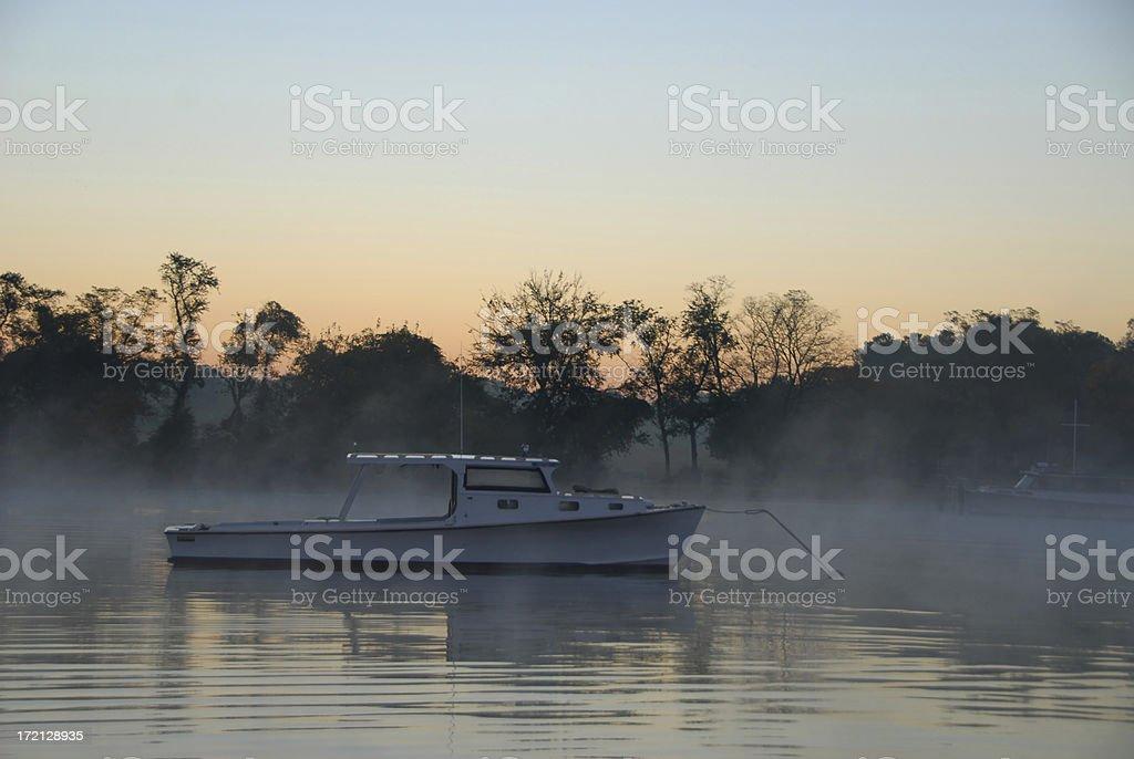 Fishing boat in the fog stock photo