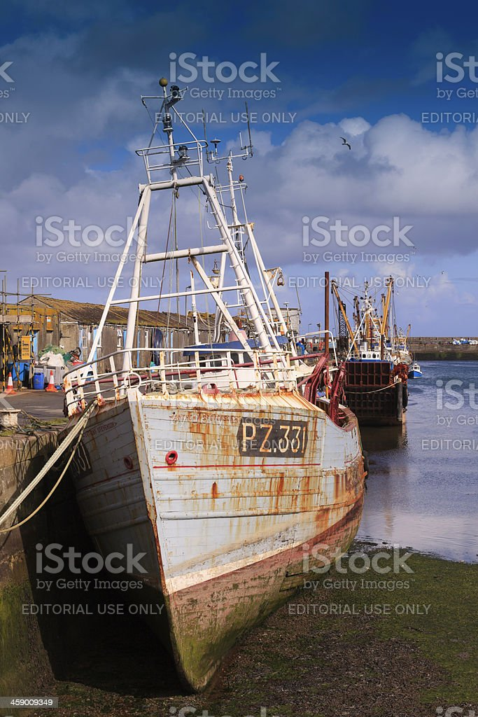 fishing boat in the harbour of Newlyn at low tide royalty-free stock photo