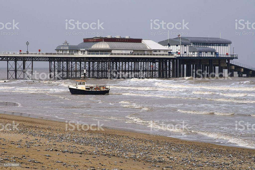 Fishing boat in the surf at Cromer royalty-free stock photo