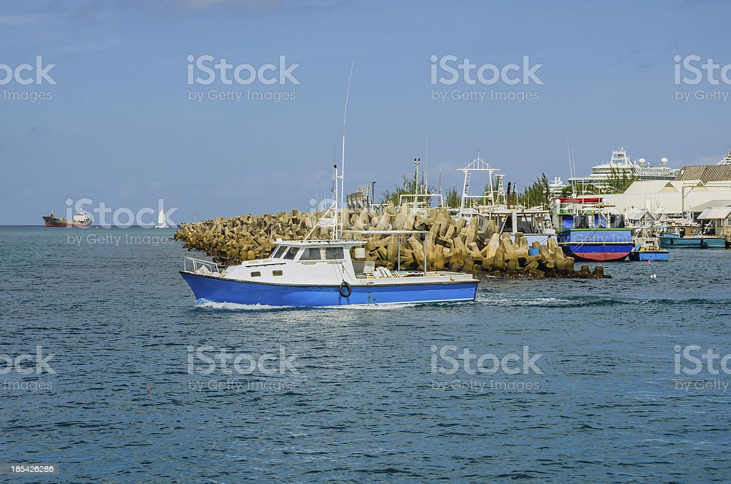 Fishing Boat Leaving a Harbour stock photo