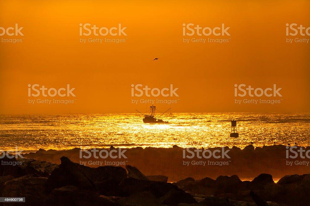 Fishing Boat Leaving Westport Sunset Buoy Grays Harbor Washington stock photo