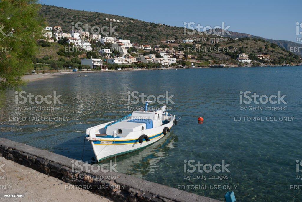 Fishing boat moored to shore of Mavrikiano, Elounda, Crete stock photo