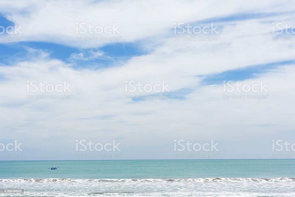 Fishing Boat off Kuta Beach royalty-free stock photo