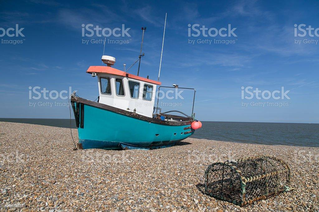 fishing boat on an English beach stock photo