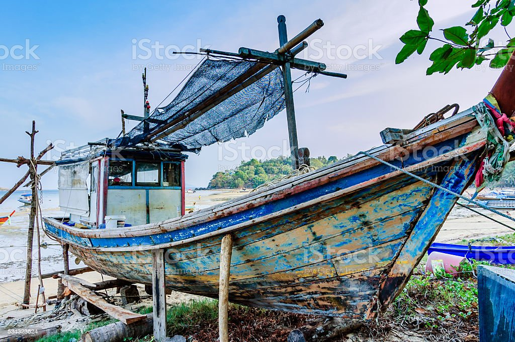 Fishing boat on beach for repairs, Phuket, Thailand stock photo