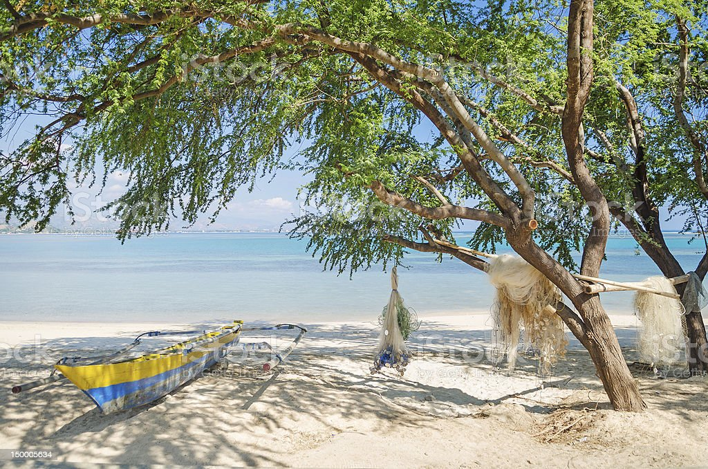 fishing boat on beach in dili east timor stock photo