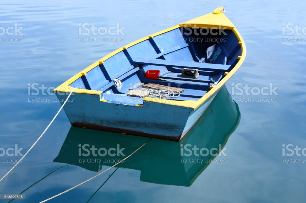 Fishing boat on calm water stock photo
