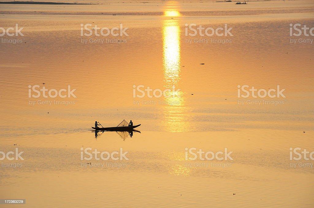 Fishing boat on Kaptai Lake at sunrise moment stock photo