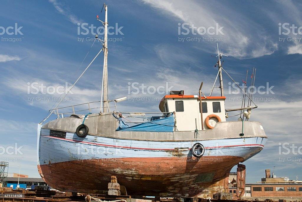 Fishing boat on land stock photo