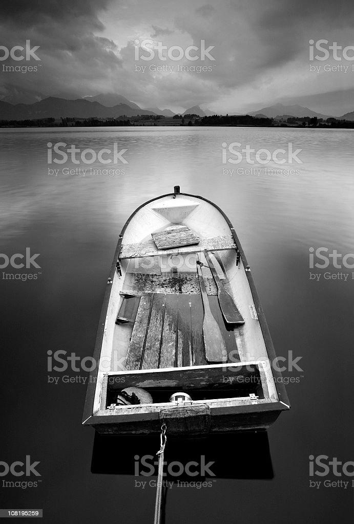 Fishing Boat on Mountain Lake, Black and White royalty-free stock photo