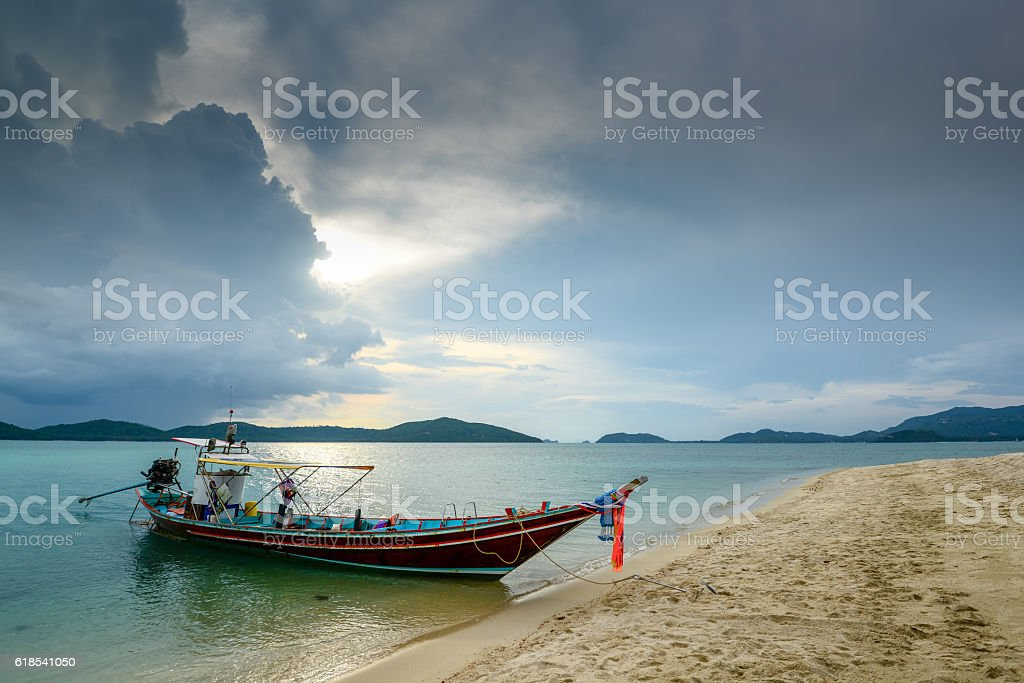 Fishing boat on sea side during about raining. stock photo
