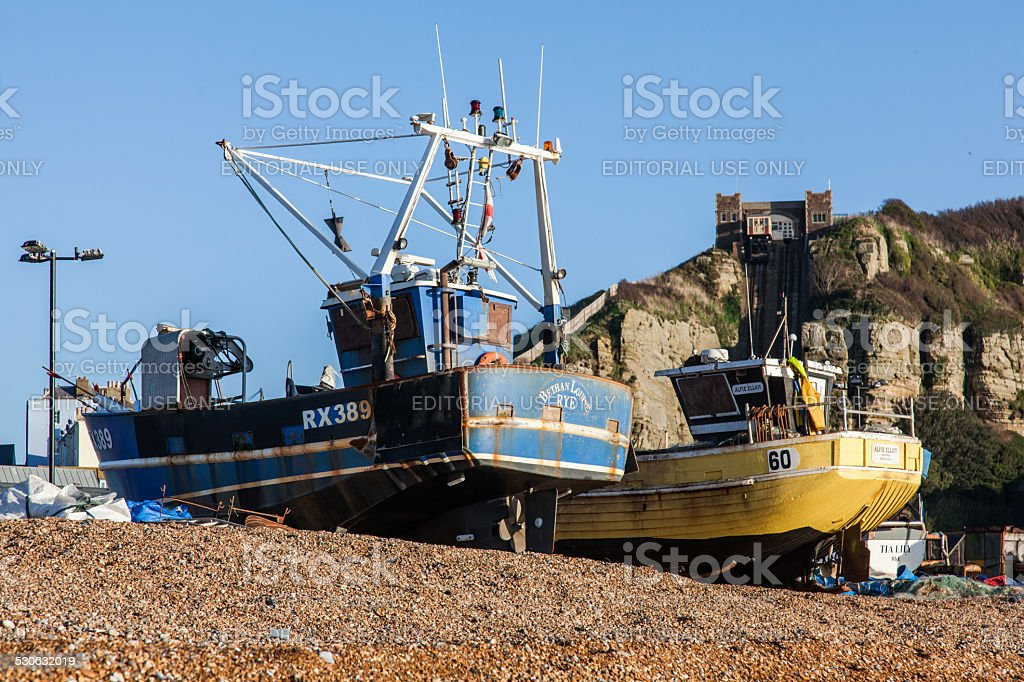 Fishing Boat on the beach at Hastings and funicular railway stock photo