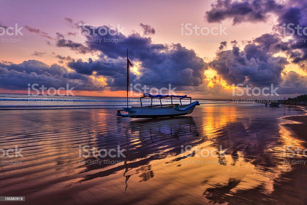 Fishing Boat on the Beach at Sunrise stock photo