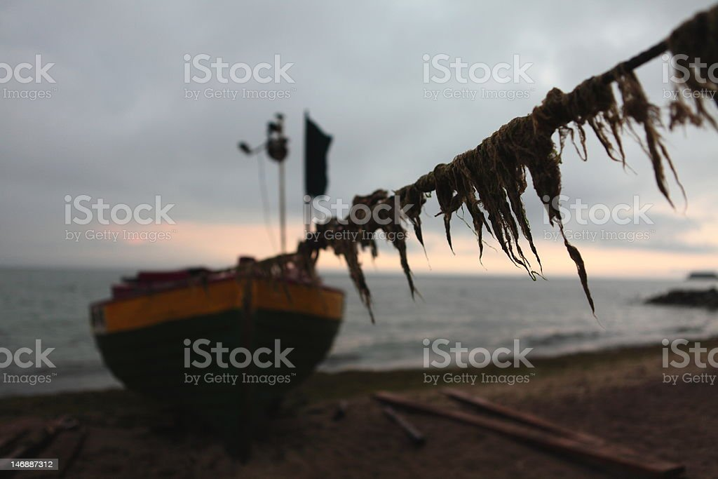Fishing boat on the beach royalty-free stock photo