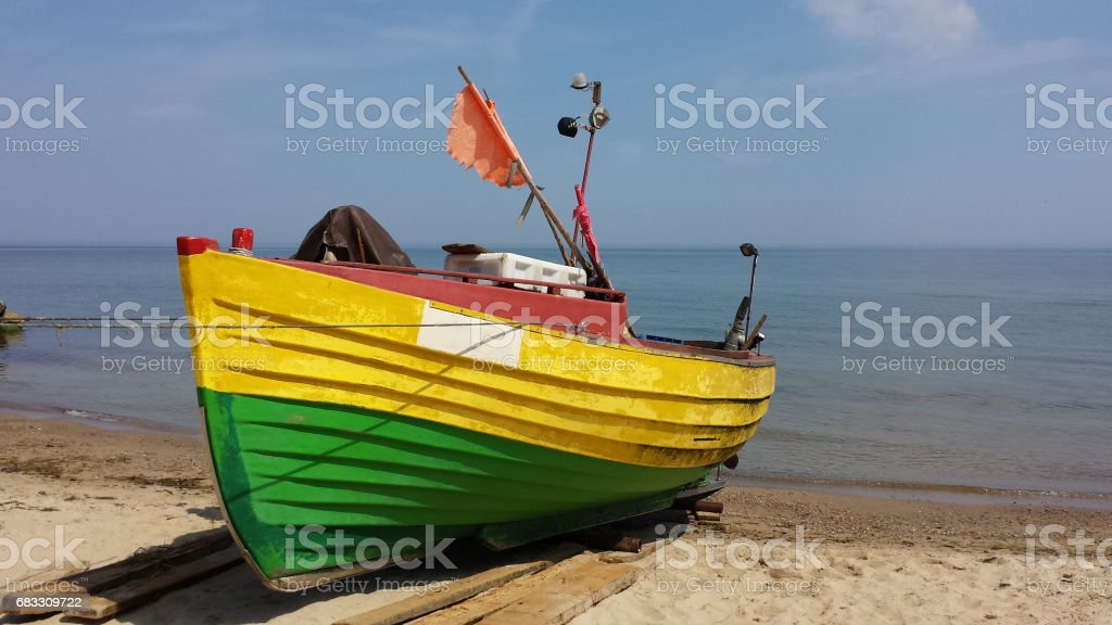 Fishing boat on the beach stock photo