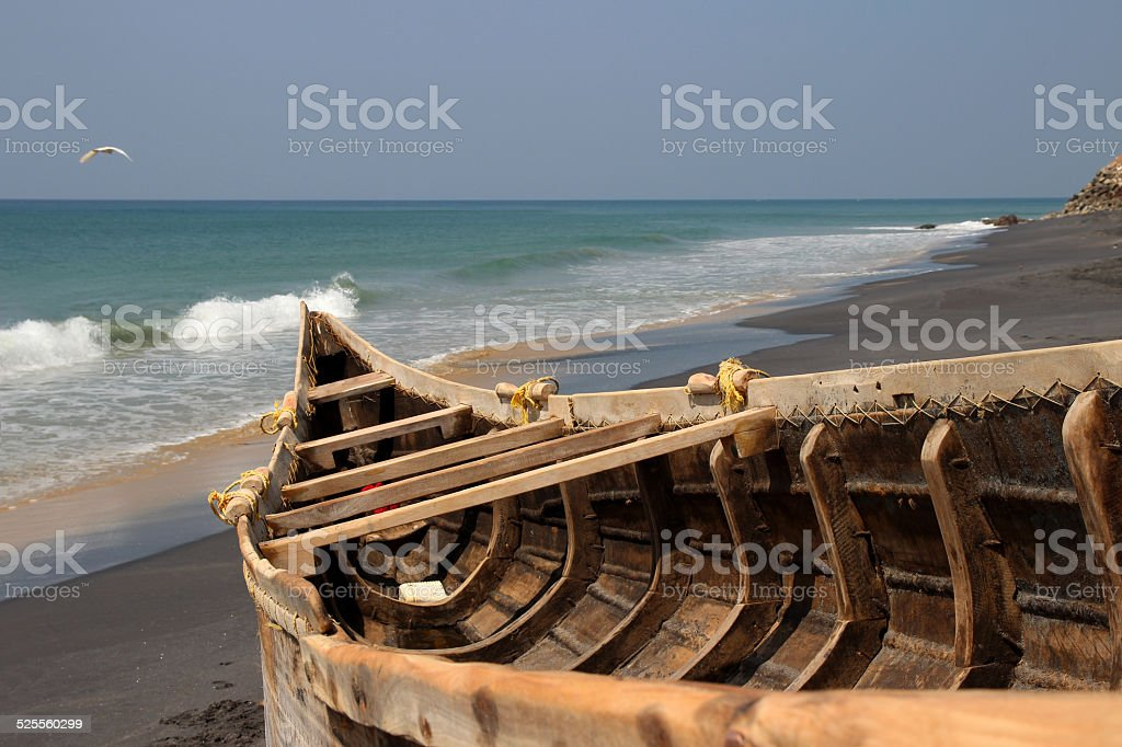 Fishing boat on the Indian ocean shore royalty-free stock photo