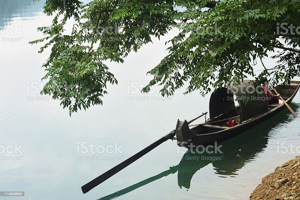 Fishing boat on the river stock photo