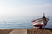 Fishing boat on the sand seashore