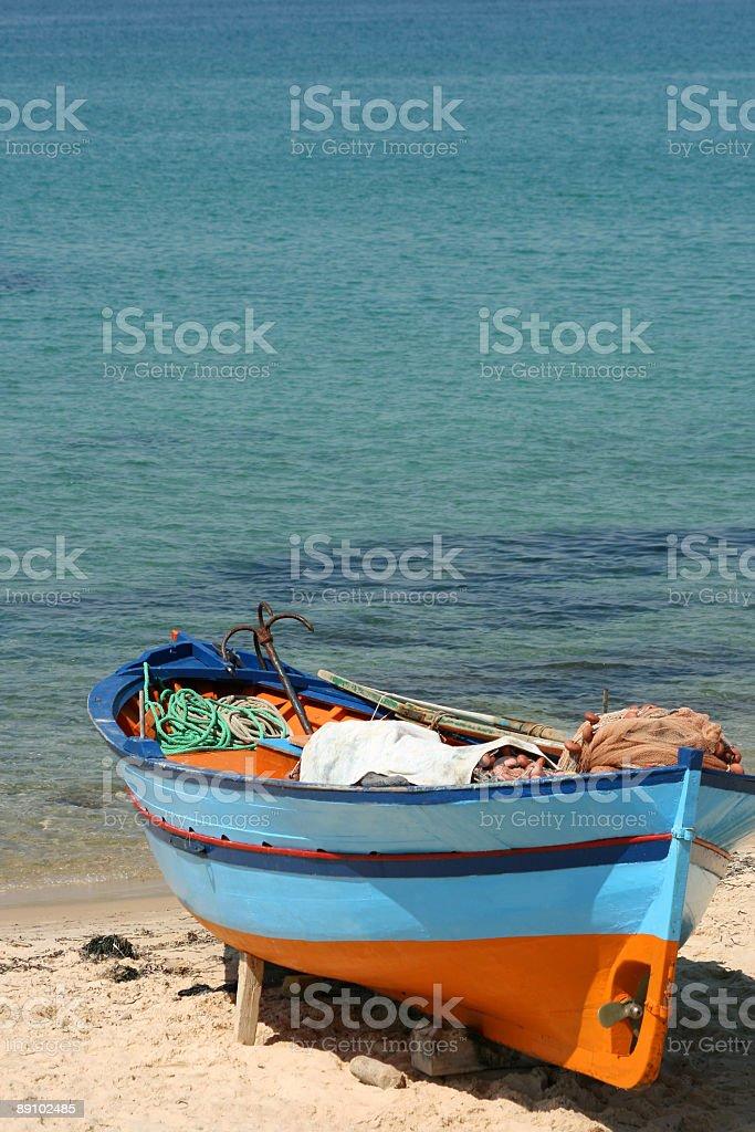 Fishing boat on the tunisian beach-Africa royalty-free stock photo