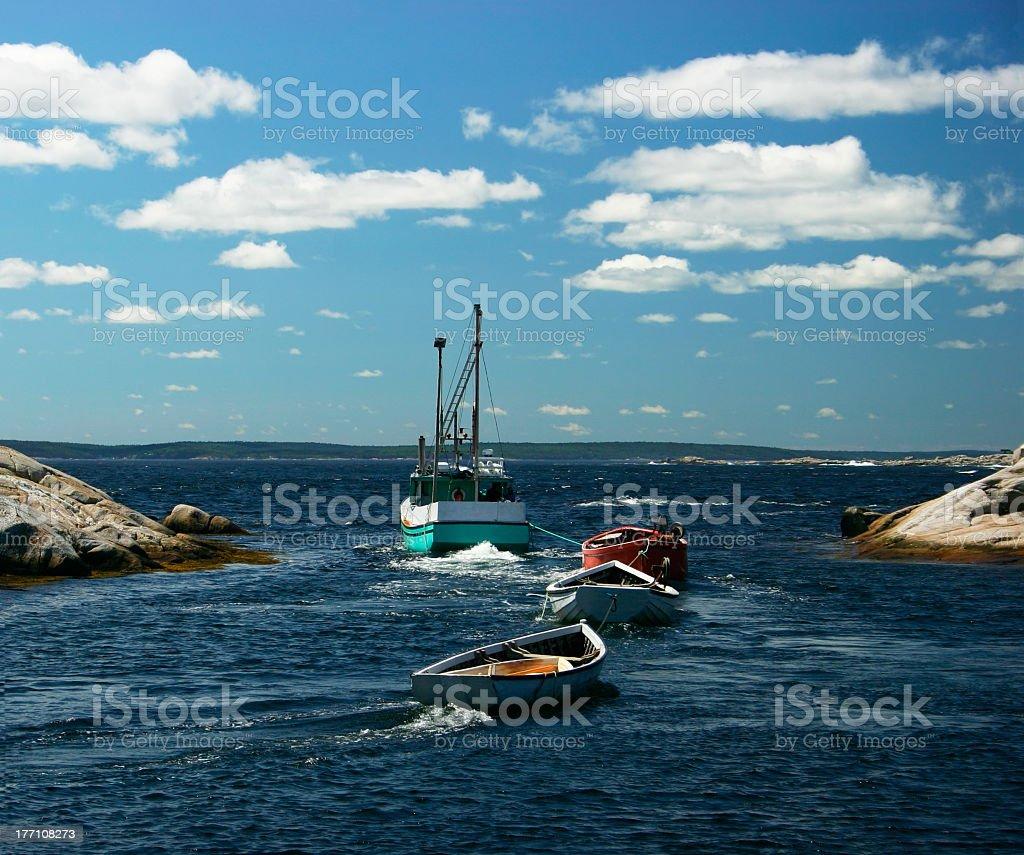 Fishing Boat Pulling Barges stock photo