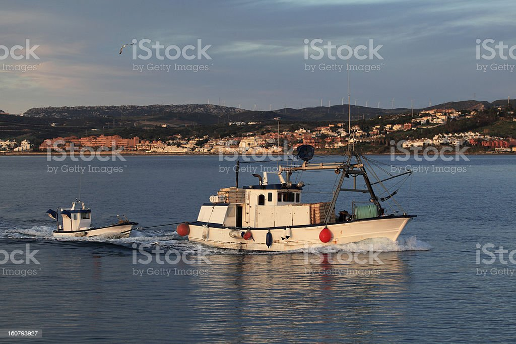 Fishing boat returning home royalty-free stock photo