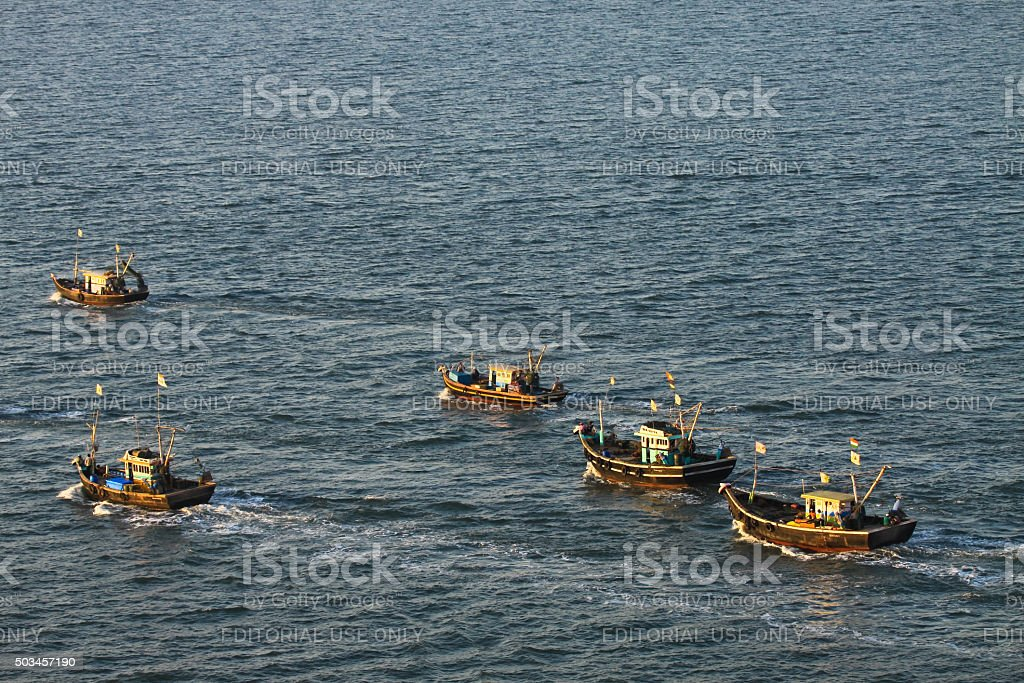 Fishing boat sailing to sea for fishing stock photo