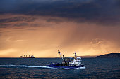 Fishing boat ship on sea in the rays