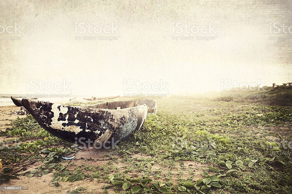 fishing boat sitting on beach, texture added royalty-free stock photo