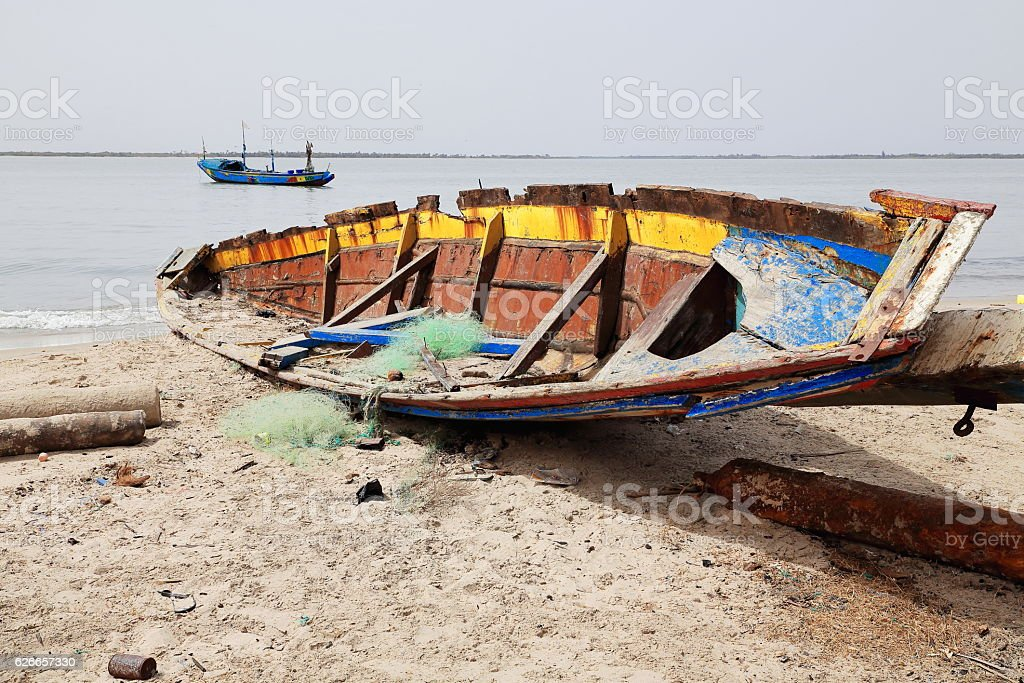 Fishing boat stranded on the beach. Diogue island-Basse Casamance-Senegal. 2069 stock photo