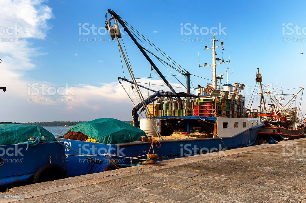 Fishing boat waiting to go out stock photo