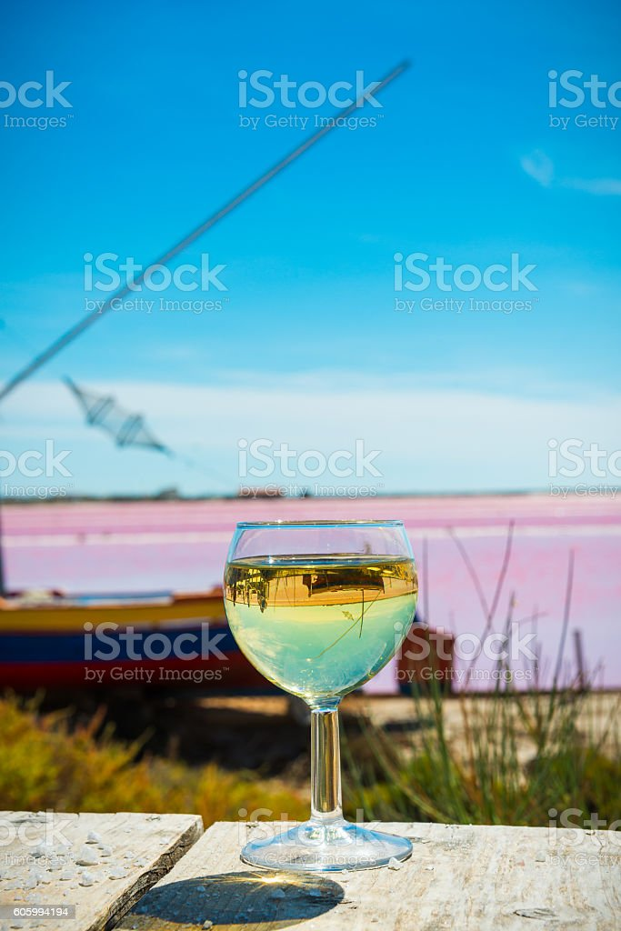 fishing boat, white wine and saline in France stock photo