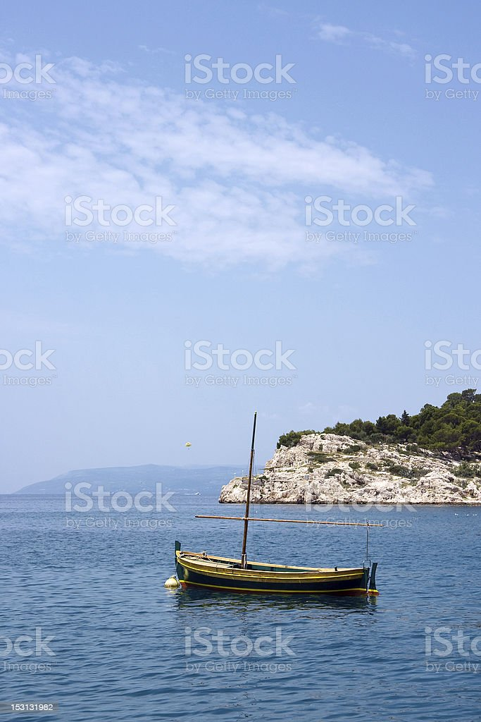 Fishing Boat with a mast in sea royalty-free stock photo