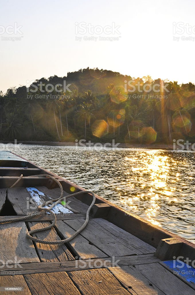 Fishing boat with sparkling light from sunset royalty-free stock photo