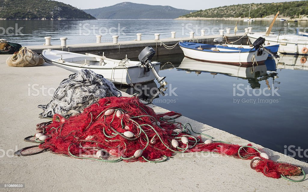 Fishing boats and nets stock photo