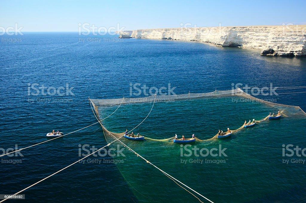 Fishing boats and nets stock photo