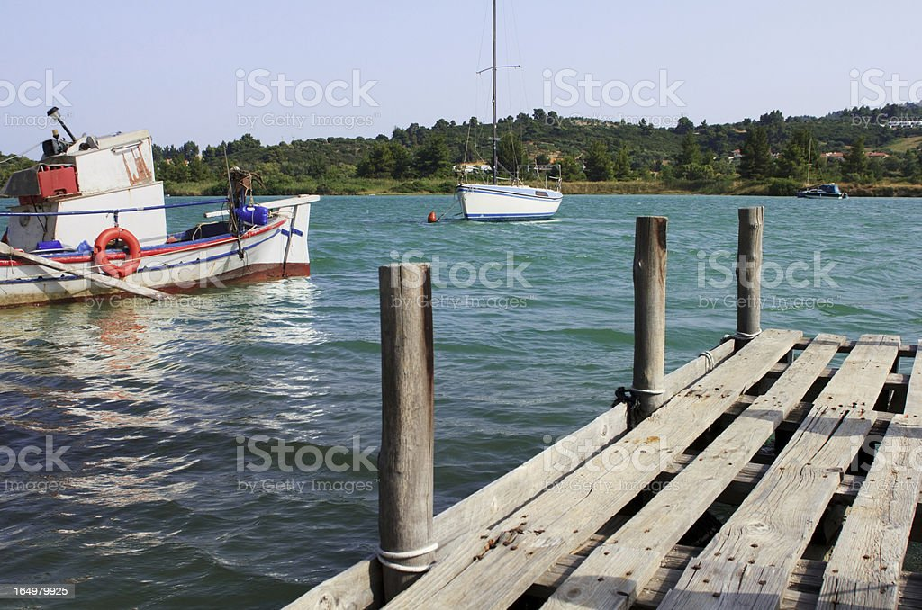 Fishing boats and pier royalty-free stock photo
