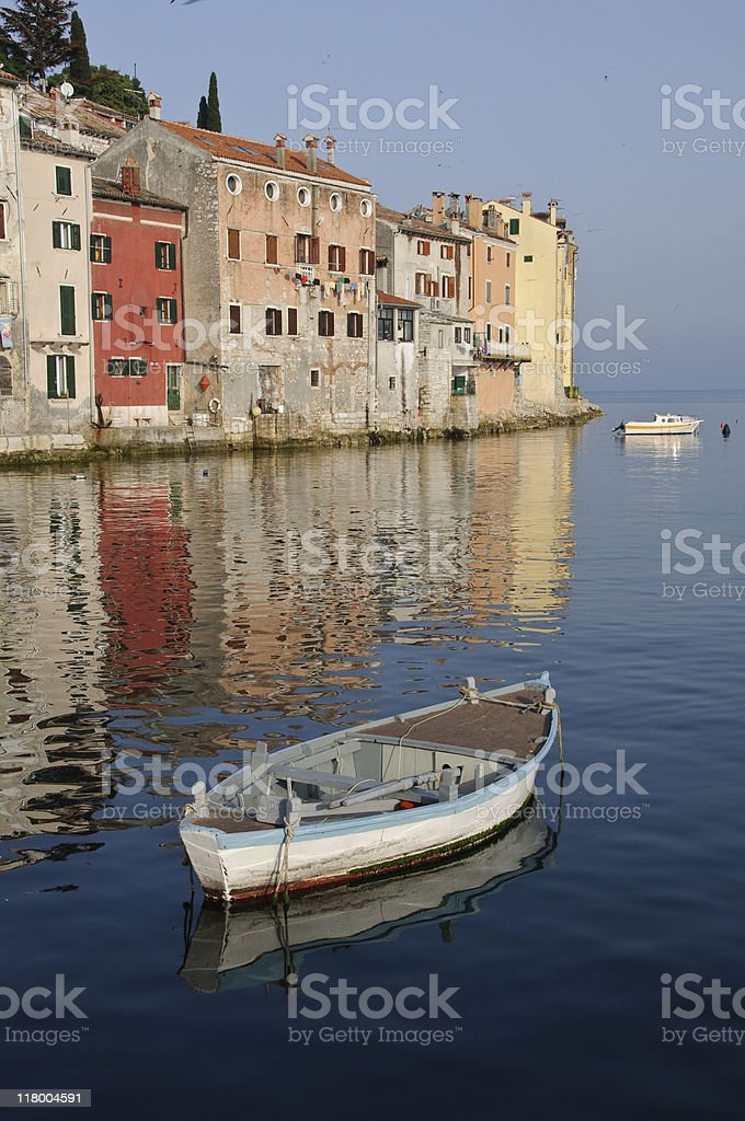Fishing Boats and Rovinj Buildings stock photo