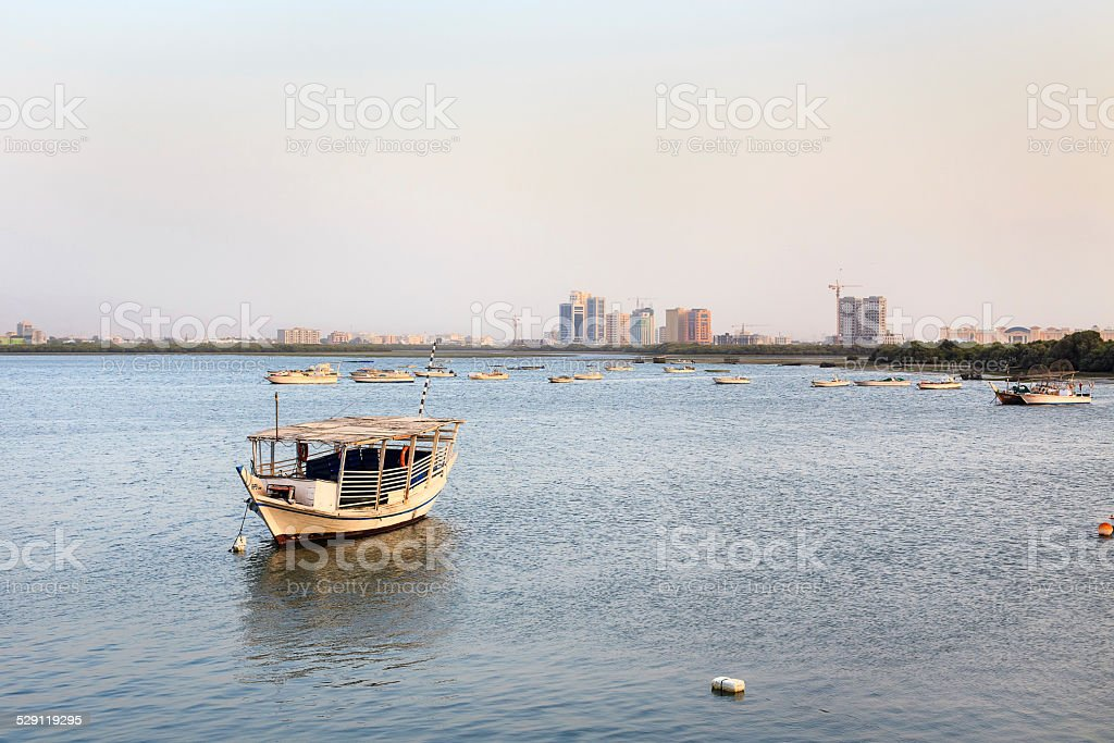 Fishing boats and skyscrapers in Ras Al Khaimah, UAE stock photo