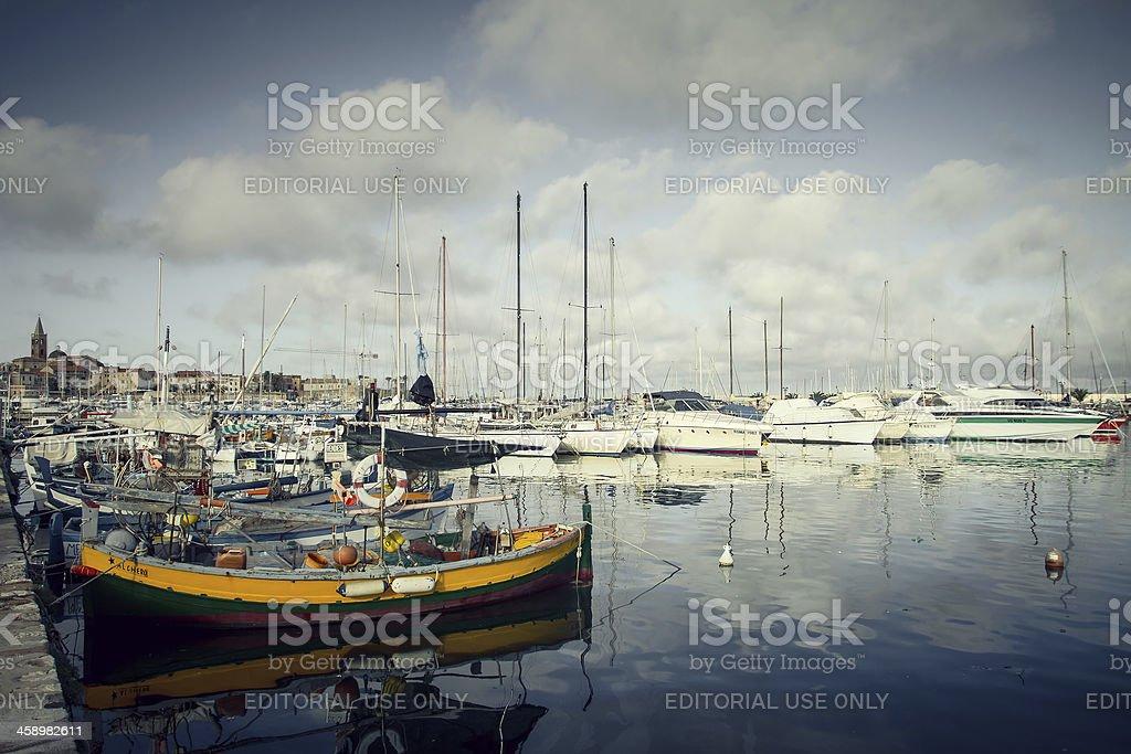 Fishing boats and yachts at the Harbor of Alghero, Sardinia royalty-free stock photo