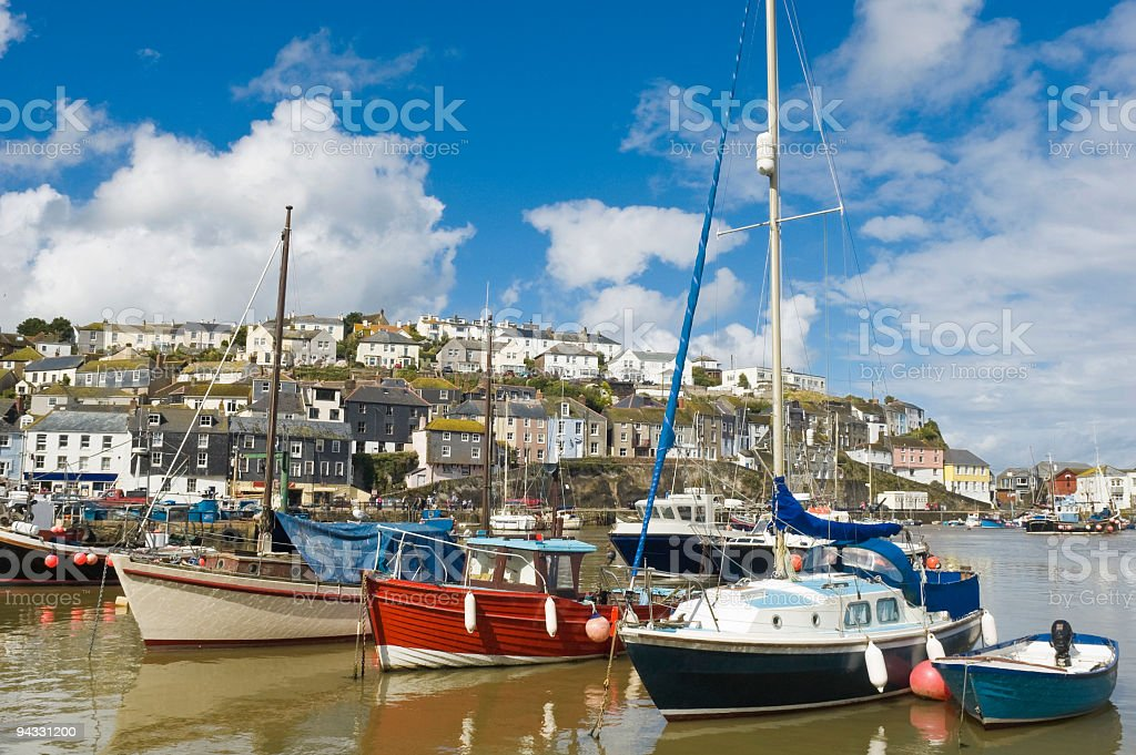 Fishing boats and yachts in harbor royalty-free stock photo