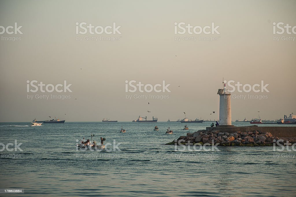 Fishing boats are moving royalty-free stock photo